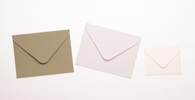 Beige and white envelopes on a white isolated