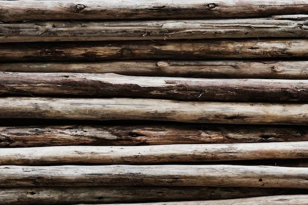 Beige wood logs textured background