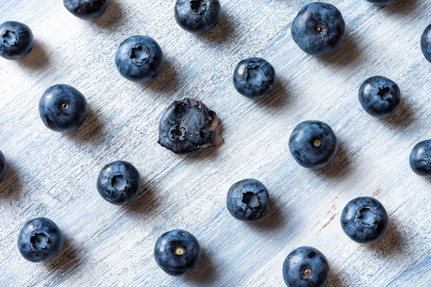 Being different concept. going against the grain or moving upstream. minimal. healthy food concept. summer fruit. blueberry pattern flat lay. copy space. creative layout. isometric