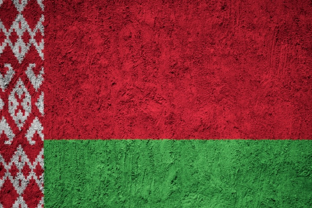 Belarus flag on the grunge concrete wall