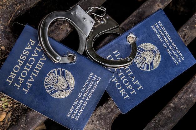 Belarusian passport in handcuffs