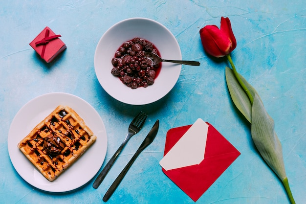 Belgian waffle with berries on plate