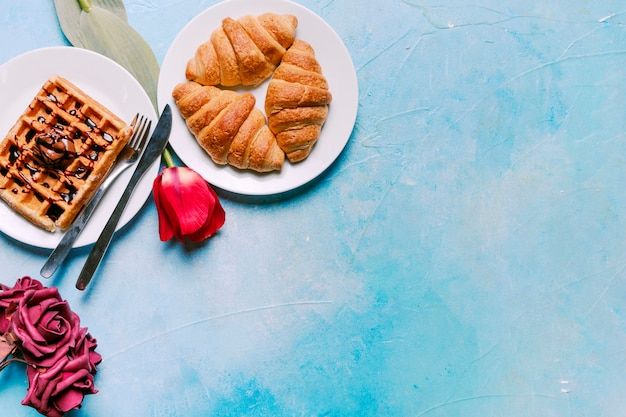 Belgian waffle with croissants and flowers