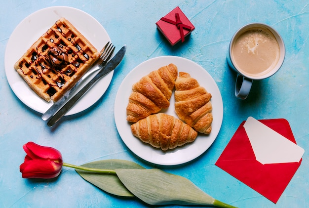 Belgian waffle with croissants on plate