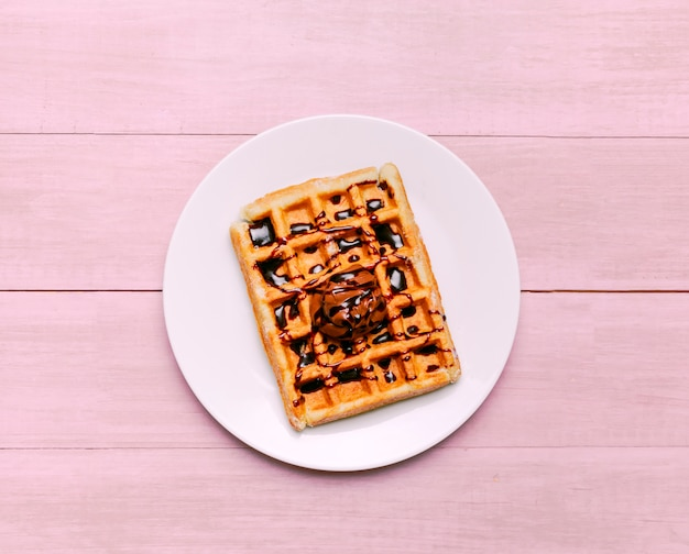 Belgian waffle with topping on plate