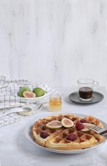 Belgian waffles figs raspberries honey espresso coffee