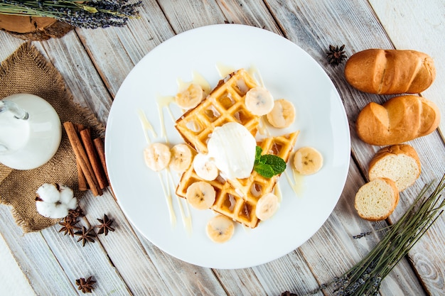 Belgian waffles poured with ice cream banana syrup