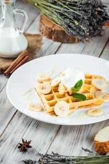 Belgian waffles poured with ice cream banana