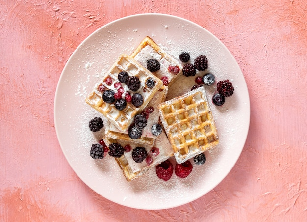 Belgian waffles with berries and honey