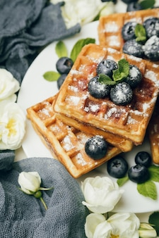 Belgian waffles with blueberries and mint