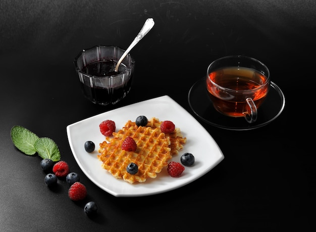 Belgian waffles with fresh berries and honey