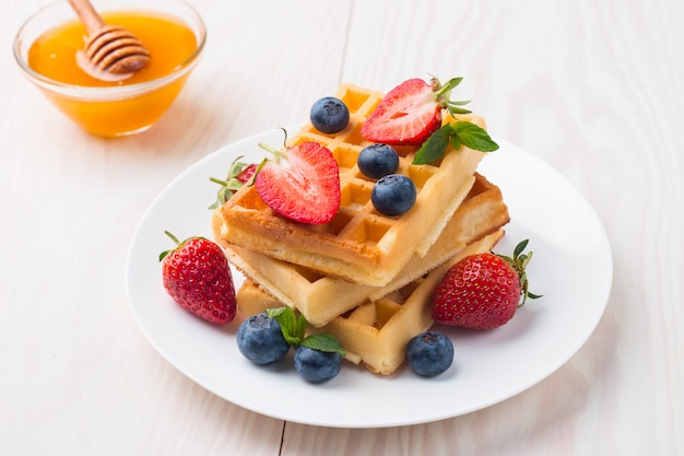Belgian waffles with fruits and honey