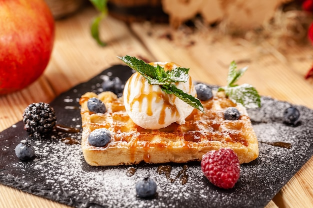 Belgian waffles with a scoop of ice cream.