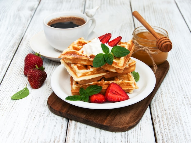 Belgian waffles with strawberries and mint