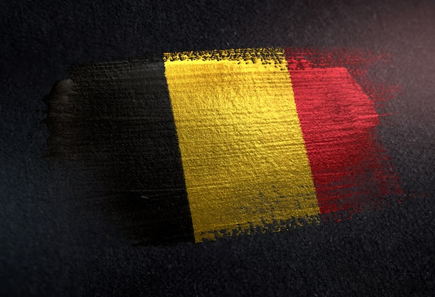 Belgium flag made of metallic brush paint on grunge dark wall