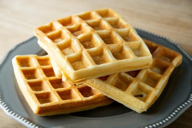 Belgium waffles close up. homemade breakfast, delcious dessert for children.
