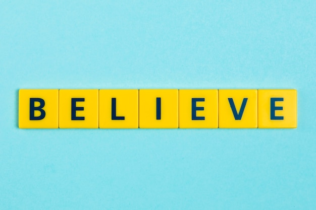 Believe word on scrabble tiles