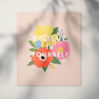 Credi in te stesso cornice floreale su un muro