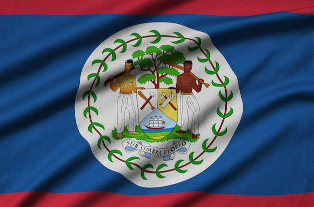 Belize flag  is depicted on a sports cloth fabric with many folds.