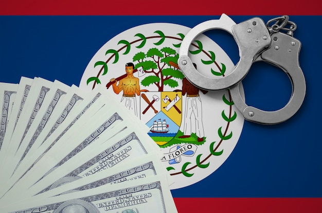 Belize flag  with handcuffs and a bundle of dollars. the concept of illegal banking operations in us currency