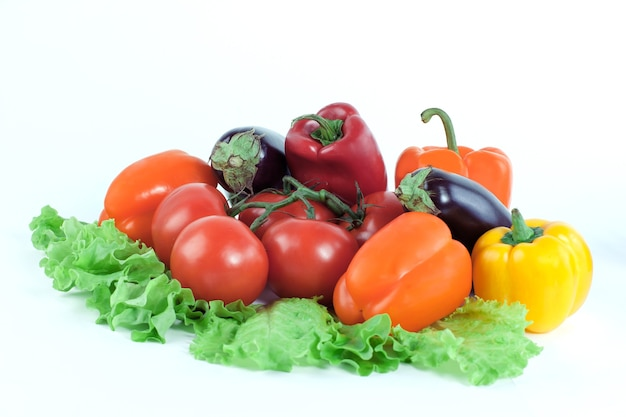 Bell pepper,eggplant on lettuce leaves isolated on white wall