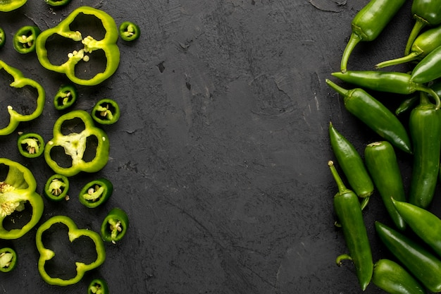 Bell pepper green fresh sliced and spicy green pepper on grey background