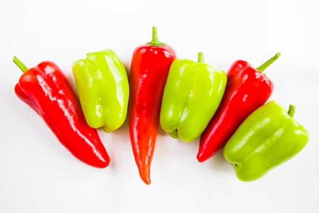 Bell pepper and green pepper on the white