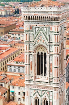 Bell tower of old town with cathedral church santa maria del fiore, florence, italy