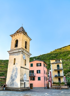 Bell tower of san lorenzo church in manarola at the cinque terre in italy