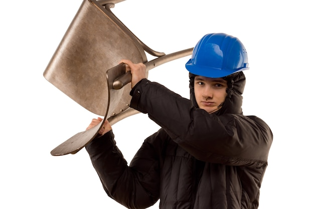 Belligerent young male thug in a hoodie and hardhat