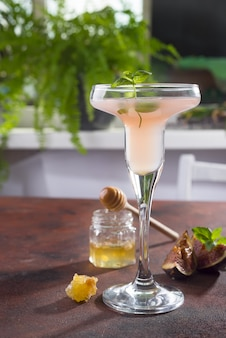Bellini cocktail with peach and figs
