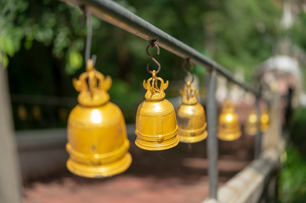 The bells of the temple are in the middle of the way up to the bell.