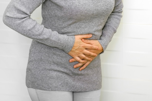 Bellyache, indigestion or menstruation. female suffering from strong stomach ache abdominal pain.