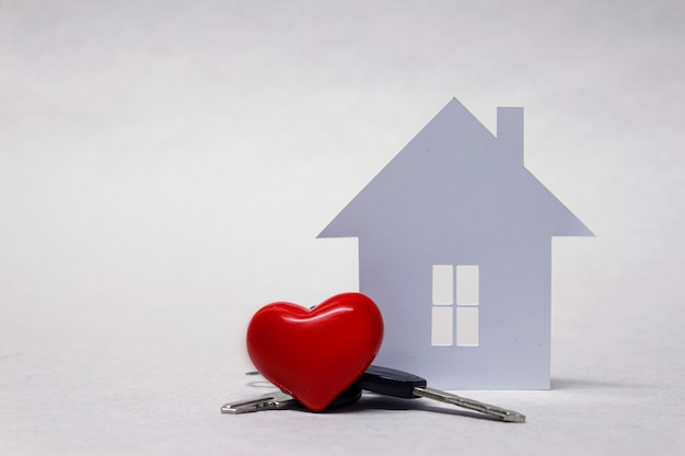 Beloved home with a red heart and a bunch of keys