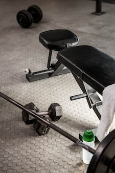 Bench and barbell at the crossfit gym