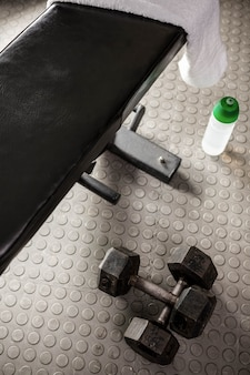 Bench and dumbbells at the crossfit gym
