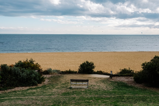 Bench lonely in park and sea and sand