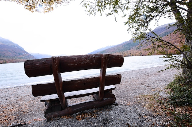 Bench near mountain lake.