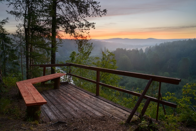 Bench with view of sunrise