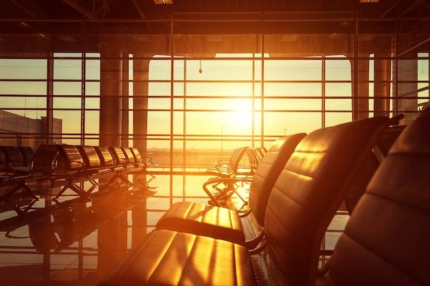 Benches in the hall of airport at sunset