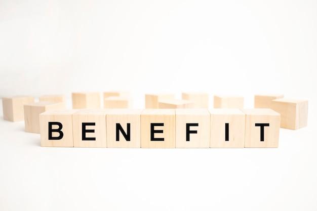 Benefits word written on wood block. concept business