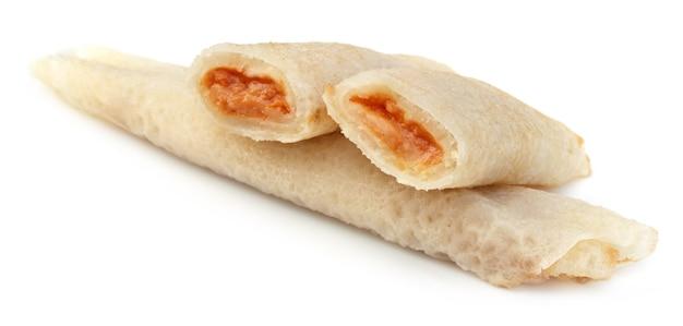 ベンガルトリート-パティシャプタピサと名付けられたココナッツフィリングのパンケーキ
