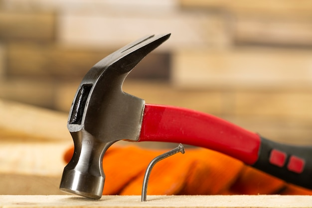 The bent nail sits on a hammer