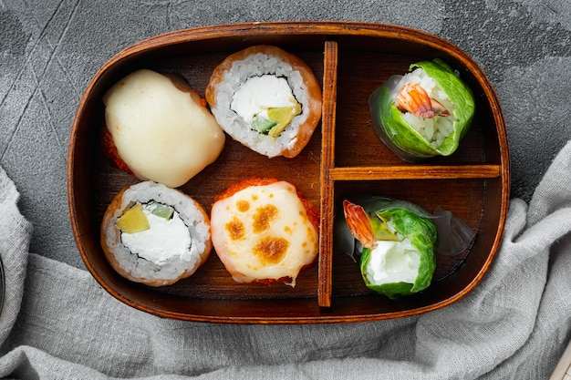 Bento lunch sushi roll set, on gray stone
