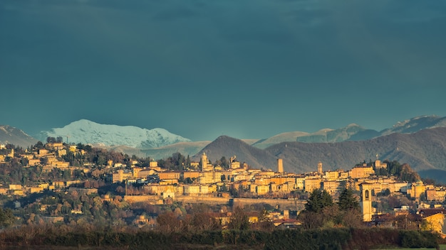 Bergamo alta  with snow in the mountains