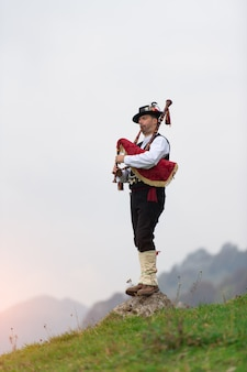 Bergamo bagpiper playing traditional instrument of northern italy