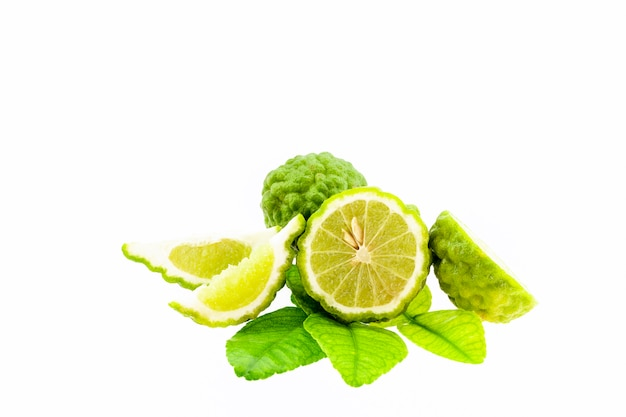 Bergamot fruit and leaves isolated on white background