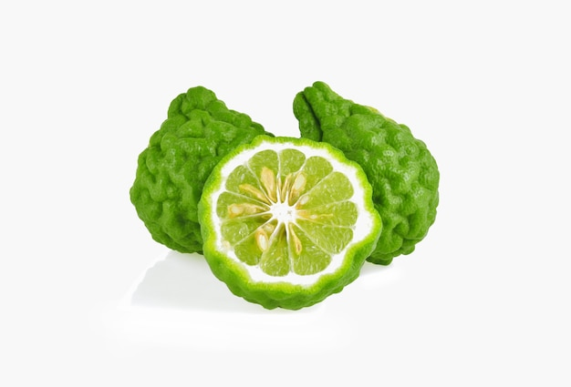 Bergamot fruit with cut in half isolated on white background.
