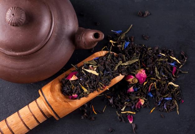 Bergamot green tea in a wooden spoon