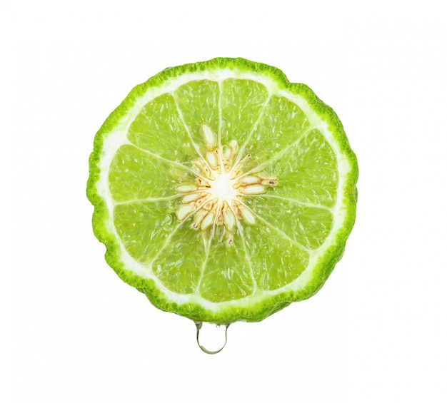 Bergamot or kaffir with juice dripping  on white background